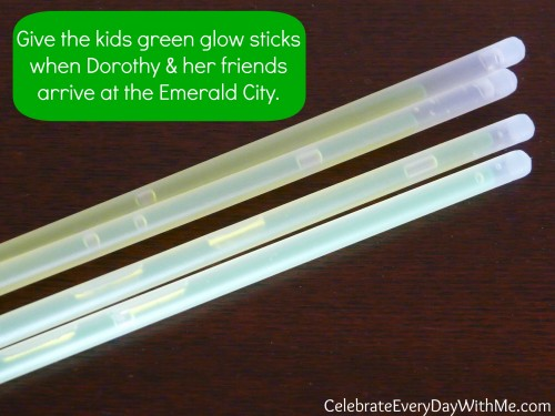 Hand out green glow sticks when Dorothy reaches the Emerald City.